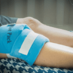 heat packs applied to knee to reduce pain